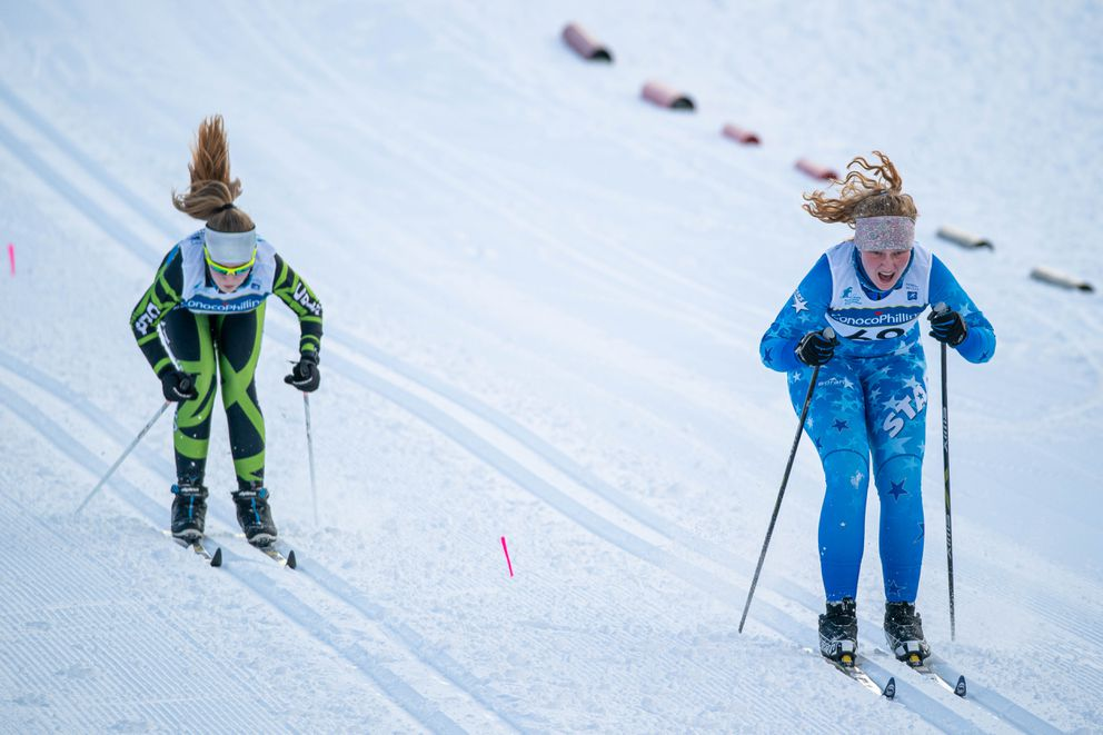 Colony's Lucy Shea, left, and Soldotna's Sonora Martin race toward the finish line in the girls 5K. (Loren Holmes / ADN)