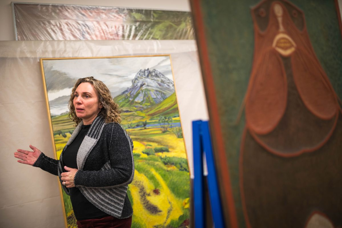 Andrea Noble-Pelant, the new executive director of the Alaska State Council on the Arts, gives a tour of the Council's Art Bank in Mountain View on Dec. 30. (Loren Holmes / Alaska Dispatch News)