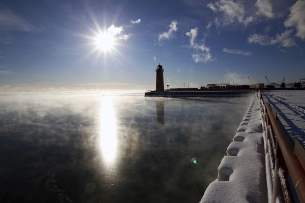 Steam rises from Lake Michigan on Friday morning, Jan. 25, 2019, in Milwaukee. An arctic wave has wrapped parts of the Midwest in numbing cold, sending temperatures plunging and prompting officials to close dozens of schools Friday, but forecasters say the worst may be yet to come. (AP Photo/Carrie Antlfinger)