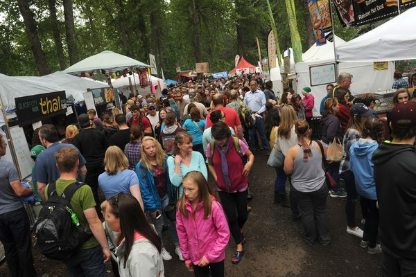A huge crowd enjoys the Girdwood Forest Fair on Saturday, July 2, 2016, in Girdwood AK. The 41st annual fair featured music, food, crafts and a hippie vibe. (Bob Hallinen / Alaska Dispatch News)