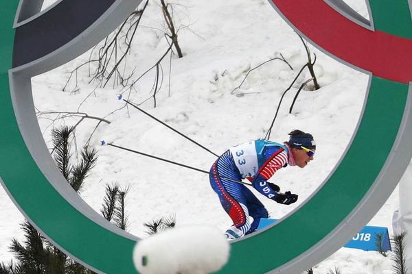 Cross-Country Skiing – Pyeongchang 2018 Winter Olympics – Men's 15km + 15km Skiathlon – Alpensia Cross-Country Skiing Centre – Pyeongchang, South Korea – February 11, 2018 - Scott Patterson of the U.S. skis past the Olympic symbol. REUTERS/Kai Pfaffenbach
