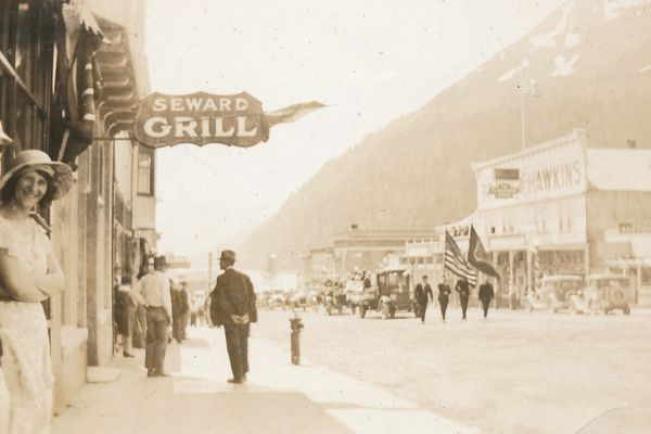 Downtown Seward shortly after noon on July 4, 1931. (Doug Capra collection) ONE TIME USE courtesy of Larry Valade, from an album compiled by his mother's sister, Helen Mulcare, in 1931). She was a 22-year-old teacher in Seward at the time. Larry is the son of Darrell Valade who was in partnership for a time with Leon Urbach, who started Urbach's Clothier in 1915. The business is still operating.