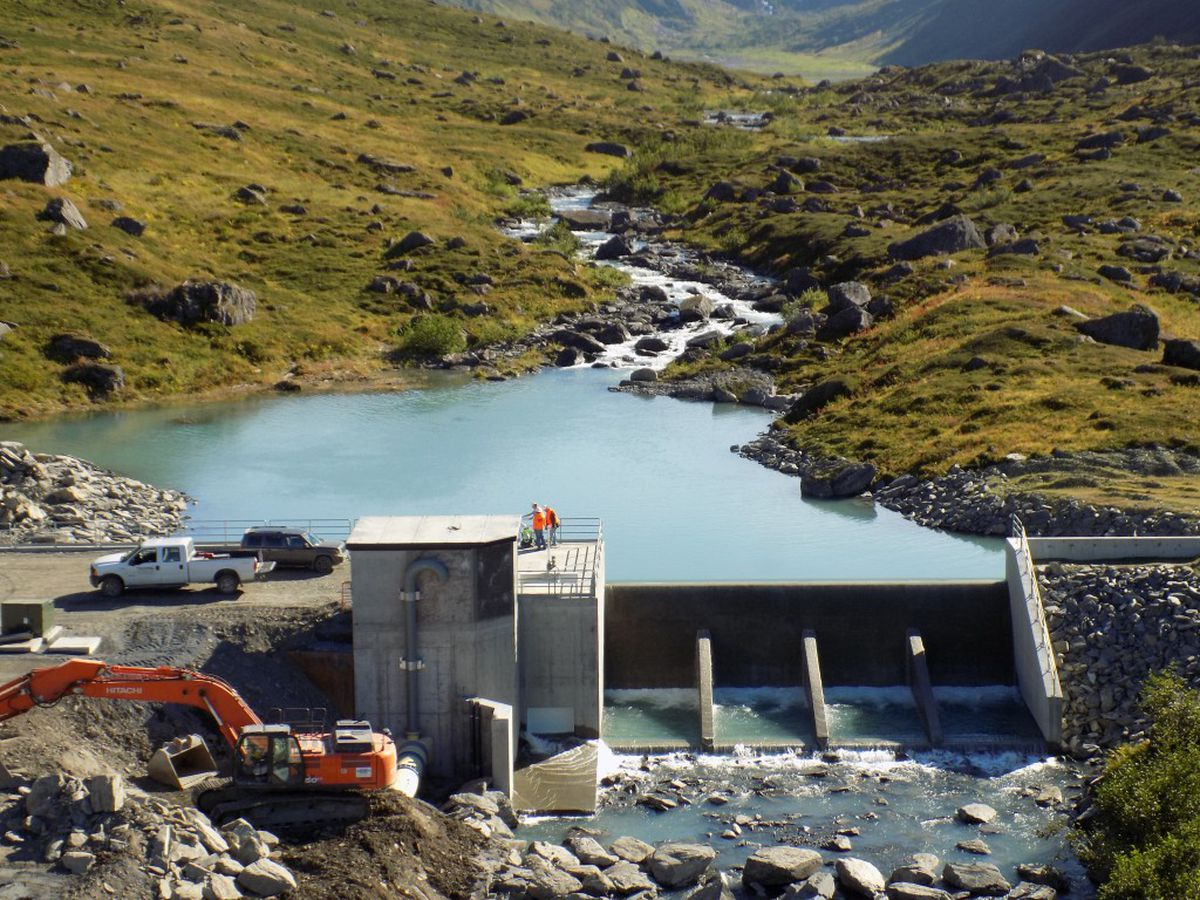 The Allison Creek Hydroelectric Project nears completion in early September of 2016. This diversion structure backs up water at Allison Creek, allowing pressure to be built before the water begins its journey toward a pipe that heads downhill to eventually spin a power-generating turbine. Excess water flows over the spillway back into the creek. (Courtesy Copper Valley Electric)