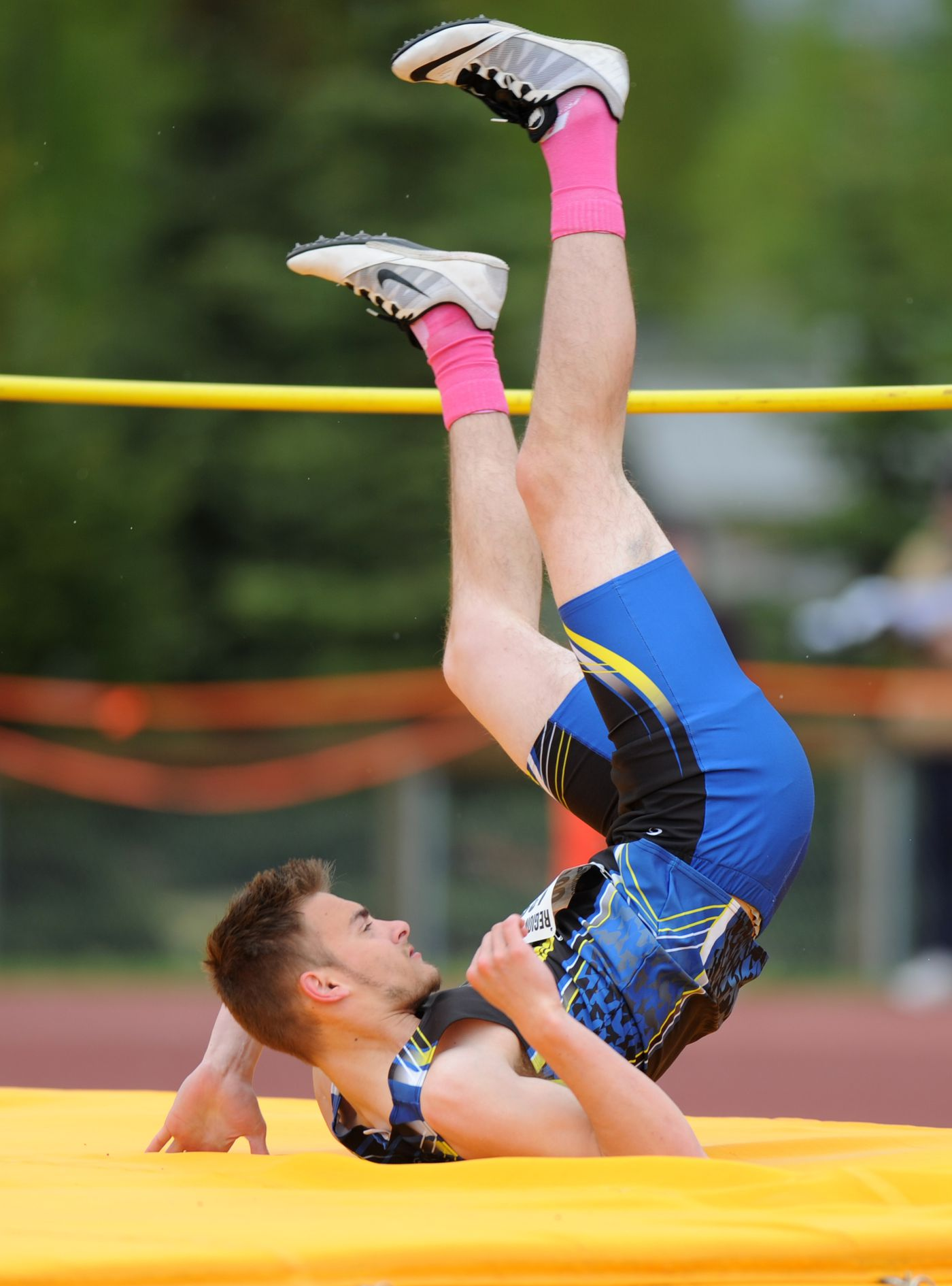 Dallas Tellef of Bartlett clears thebar en route to a third-place finish in the high jump. (Erik Hill / Alaska Dispatch News)