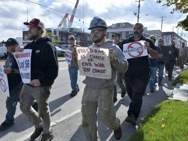 U.S. vaccine mandates create conflict with defiant workers
