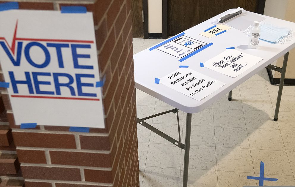 Masks and hand sanitizer greet voters at the polling place at Redeemer Lutheran Church, Tuesday, May 12, 2020 in Lincoln, Neb. (Gwyneth Roberts/Lincoln Journal Star via AP)