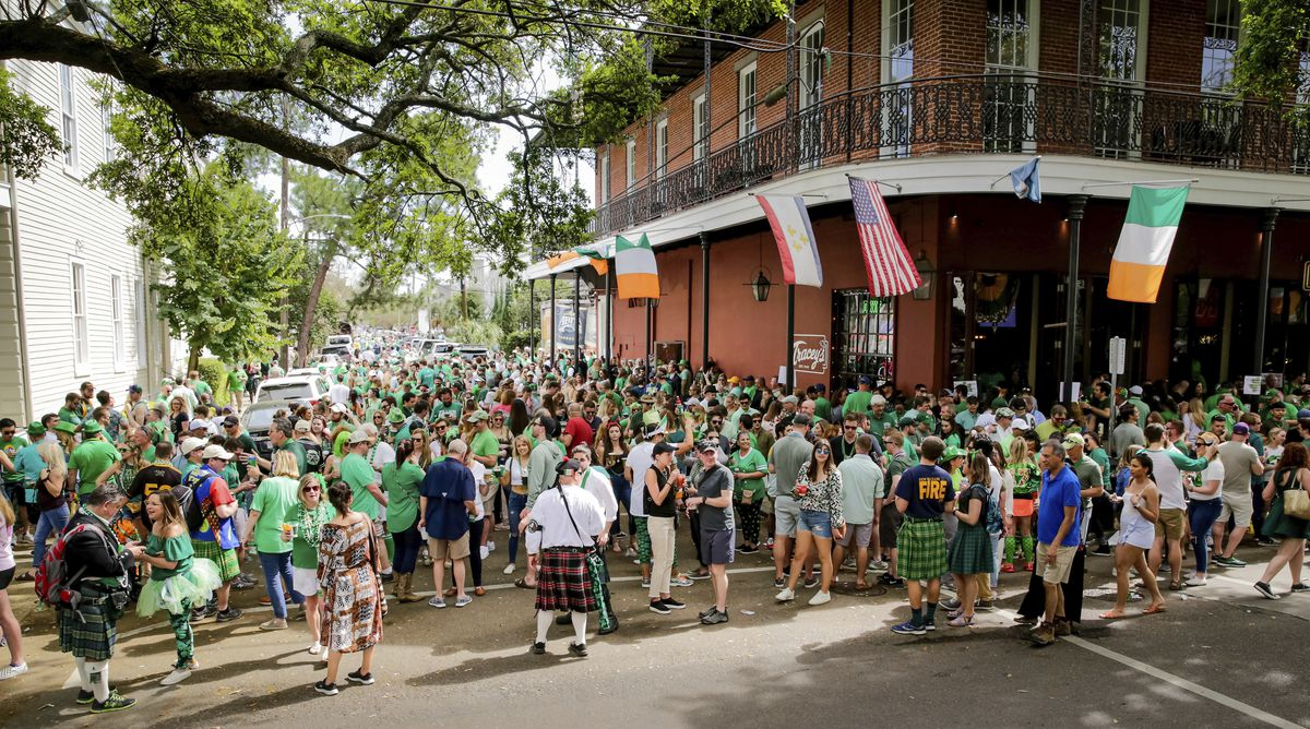 Revelers celebrate St. Patrick's Day Saturday, March 14, 2020, during an unofficial gathering at Tracey's Original Irish Channel Bar in New Orleans. (Scott Threlkeld/The Advocate via AP)