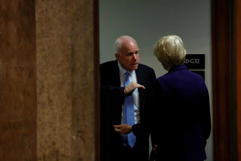 Senate Armed Services Committee Chairman Sen.John McCain (R-AZ) speaks with Sen.Elizabeth Warren (D-MA) before a hearing on foreign cyber threats, with testimony by U.S. Director of National Intelligence James Clapper, on Capitol Hill in Washingtonon Thursday. REUTERS/Jonathan Ernst