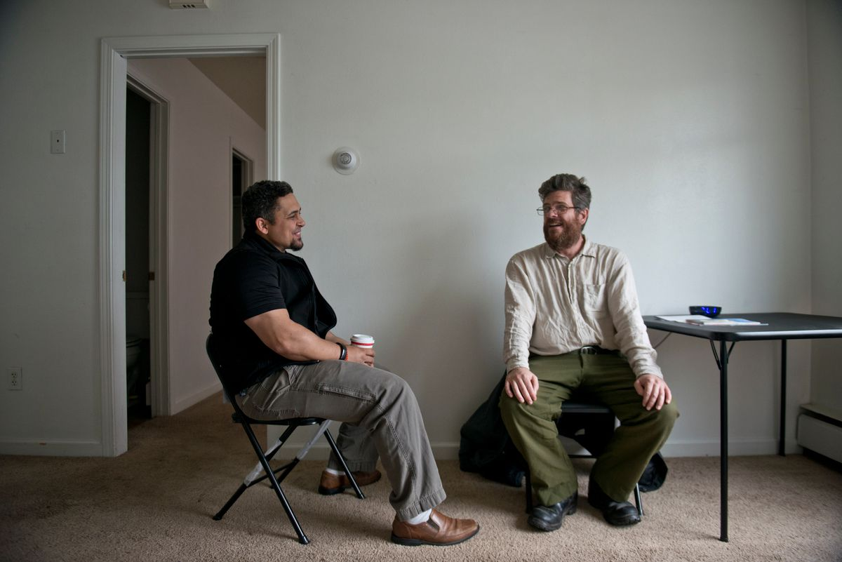 Jeff Ensley, right, works with Choices Inc., an Anchorage organization that assists people with mental illness. They helped him find a place to live. He speaks with Choices Inc. mental health clinician Jason Robinson, left. (Photo by Marc Lester / Alaska Dispatch News)