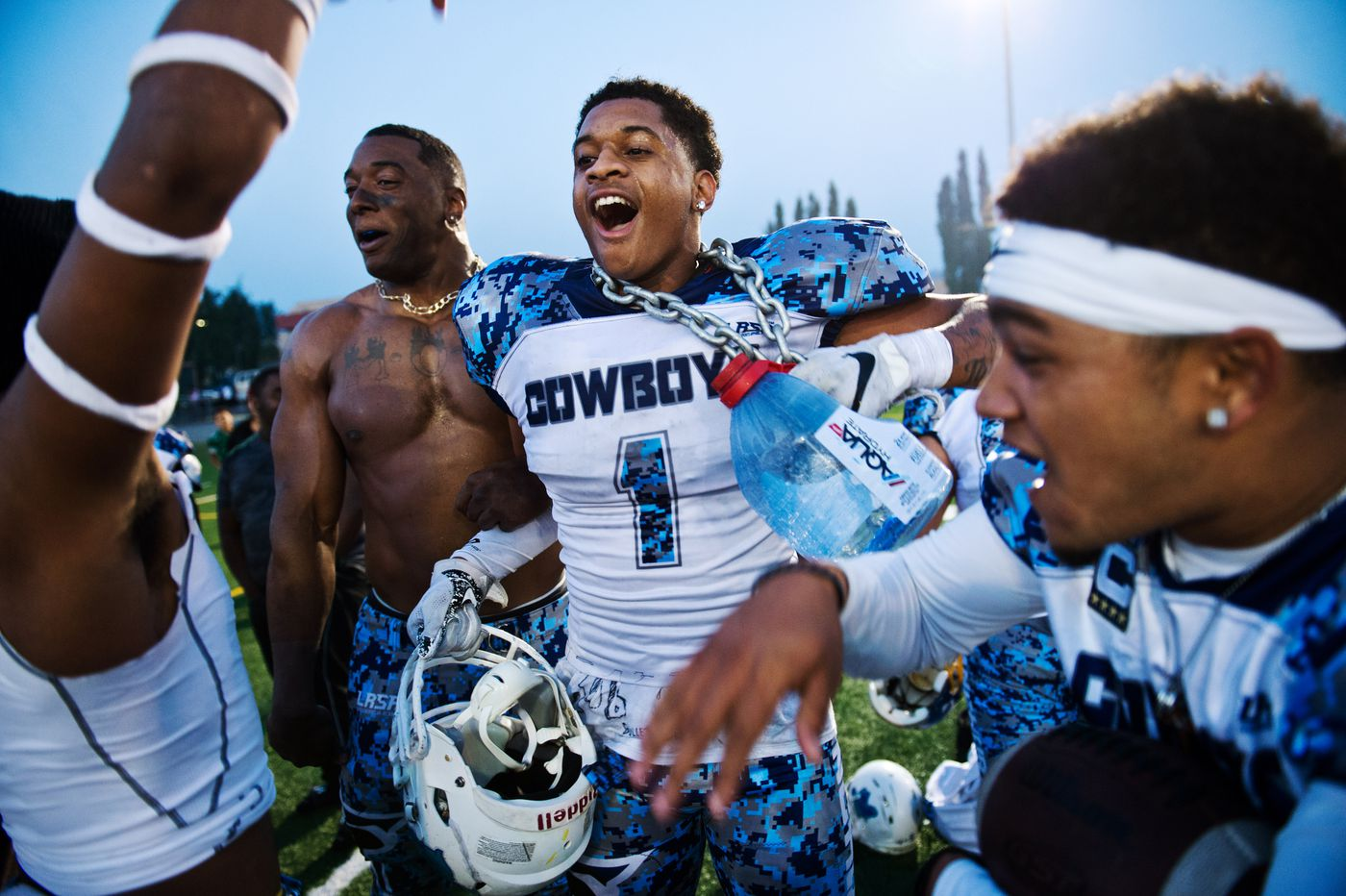 Trey Taylor, center, celebrates with his Anchorage Cowboys teammates after a lopsided win over the Greatland Packers on Sept. 3, 2018. (Marc Lester / ADN)