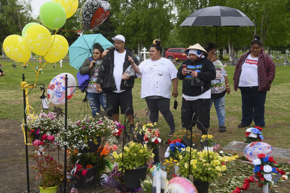 Family members of Urata Silao-Faitau visit her gravesite at Anchorage Memorial Park Cemetery on May 31, 2021. (Marc Lester / ADN)
