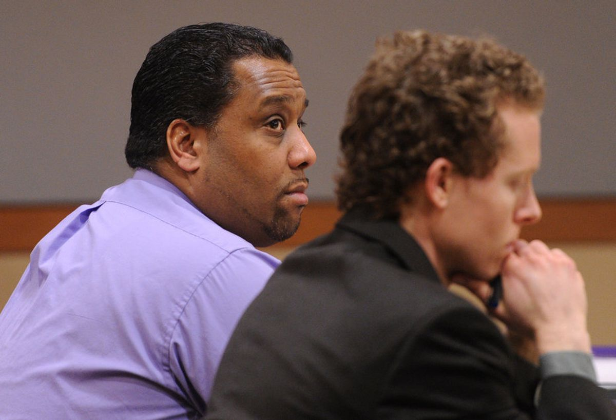 Former Rumrunner's bouncer Murville Lampkin, left, sits with public defender Lars Johnson during an assault trial on Thursday, Jan. 9, 2014. (Bill Roth / Anchorage Daily News)