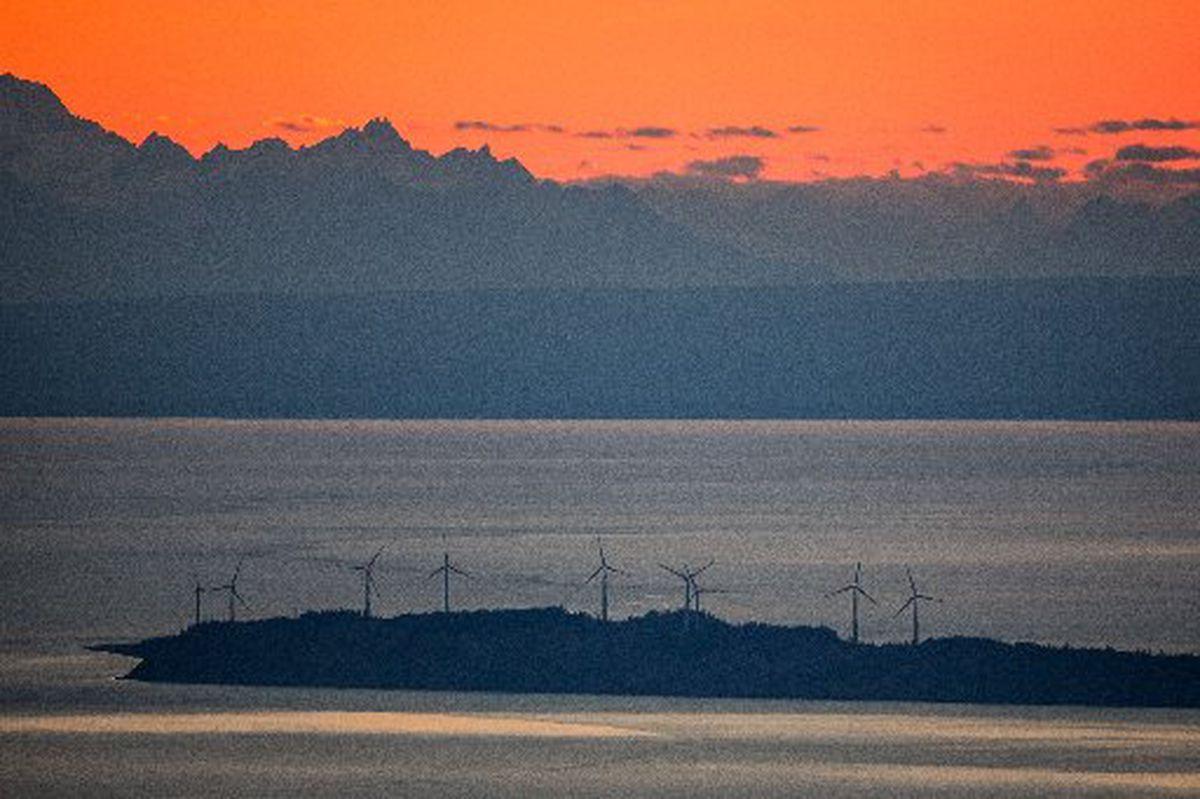 Wind turbines on Fire Island near Anchorage, seen from Glen Alps in September, 2014. (LOREN HOLMES / Alaska Dispatch News)