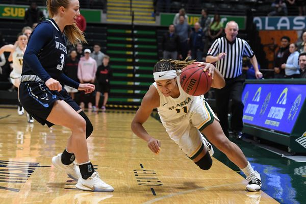 Lexie Bland, of the Western Washington Vikings comes in on defense as Safiyyah Yasin of the UAA Seawolves scoops up the loose ball in womenÕs basketball action at the Alaska Airlines Center in Anchorage, AK on Saturday, February 22, 2020. (Photo by Bob Hallinen)