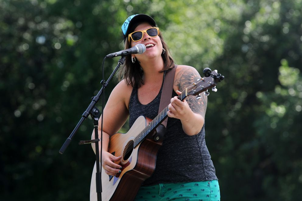 Emma Hill sings as she and Bryan Daste perform at the Live @the Library concert series midday July 6, 2017, at Loussac Library. (Erik Hill / ADN archive)