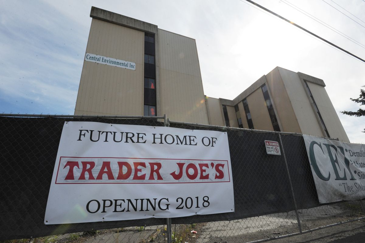 A fake sign proclaiming the opening of a future Trader Joe's location was visible to motorists traveling on Northern Lights Boulevard past the demolition site of the Northern Lights Inn on June 25, 2017. (Bill Roth / ADN archive)
