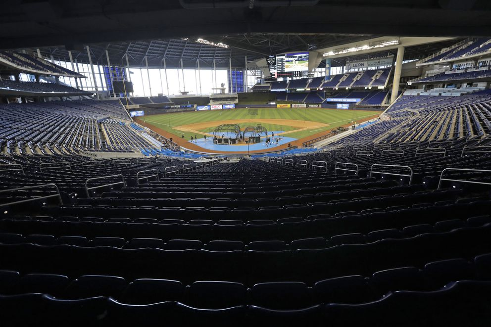 Miami Marlins take batting practice during a baseball workout at Marlins Park, Thursday, July 16, 2020, in Miami. (AP Photo/Wilfredo Lee)