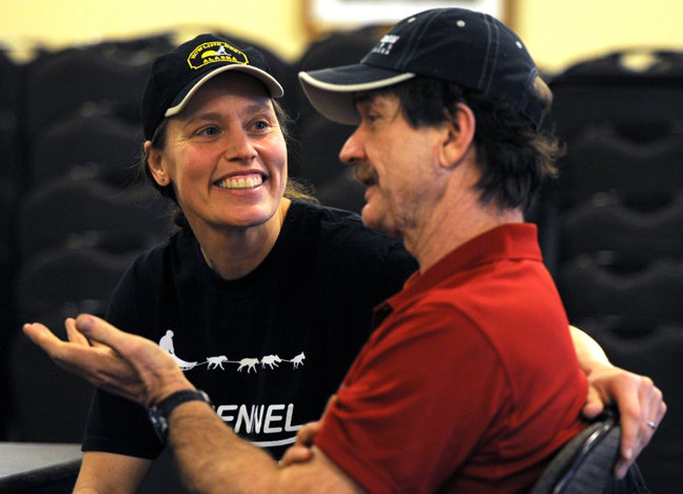 Aliy Zirkle and Allen Moore share a laugh before the 2013 Iditarod. (Erik Hill / ADN archives)