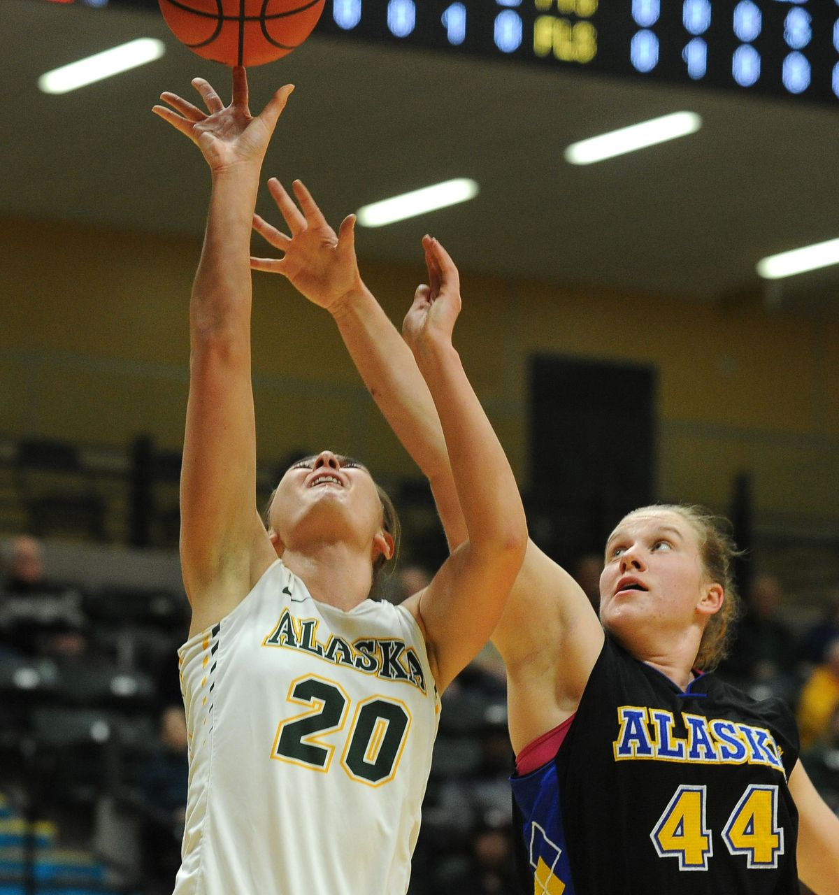 Hannah Wandersee of UAA goes up for a shot against UAF's Marian Wamsley at the Alaska Airliness Center on Tuesday. (Bob Hallinen / ADN)
