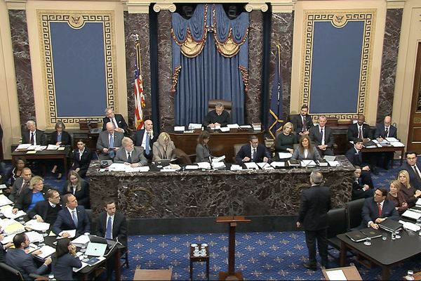 In this image from video, White House counsel Pat Cipollone, stands and waits to be recognized by presiding officer Supreme Court Chief Justice John Roberts during the impeachment trial against President Donald Trump in the Senate at the U.S. Capitol in Washington, Tuesday, Jan. 21, 2020. (Senate Television via AP)