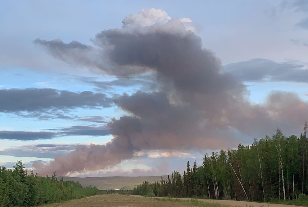The Isom Creek Fire (#187) burning southeast of the Dalton Highway Yukon River Crossing picked up activity Saturday night, June 6, 2020, and created this plume. This photo was taken at 10 p.m. from the 5 Mile airstrip located five miles north of the river crossing, which is at milepost 55 of Dalton Highway. (Photo by Cammy Roy / BLM AFS)
