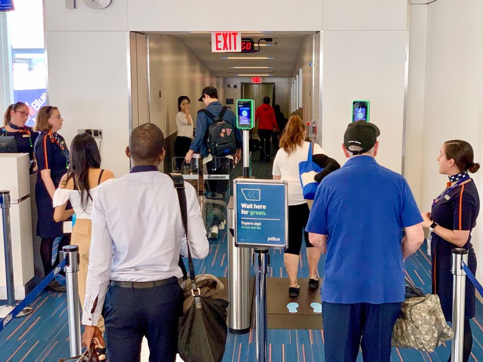 At New York's John F. Kennedy airport, JetBlue's international passengers pass through an 'e-gate ' that verifies identity by scanning their faces. MUST CREDIT: Washington Post by Geoffrey A. Fowler