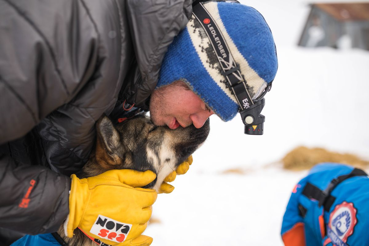 Joar Leifseth Ulsom talks to his dog Kusko, who he dropped at the White  Mountain