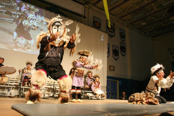 Bethel's Cama-i Dance Festival kicked off Friday night, April 17, 2015, with a lineup of traditional -- and some not so traditional -- dances. Chuna McIntyre, on the right, who is originally from Eek and lives in California now, led the Nunamta Yup'ik Singers and Dancers. He was honored as a