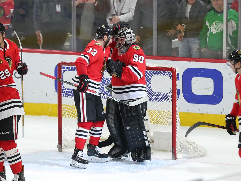 Chicago Blackhawks goalie Scott Foster is congratulated by right wing Tomas Jurco following the victory over the Winnipeg Jets. (Dennis Wierzbicki-USA TODAY Sports)