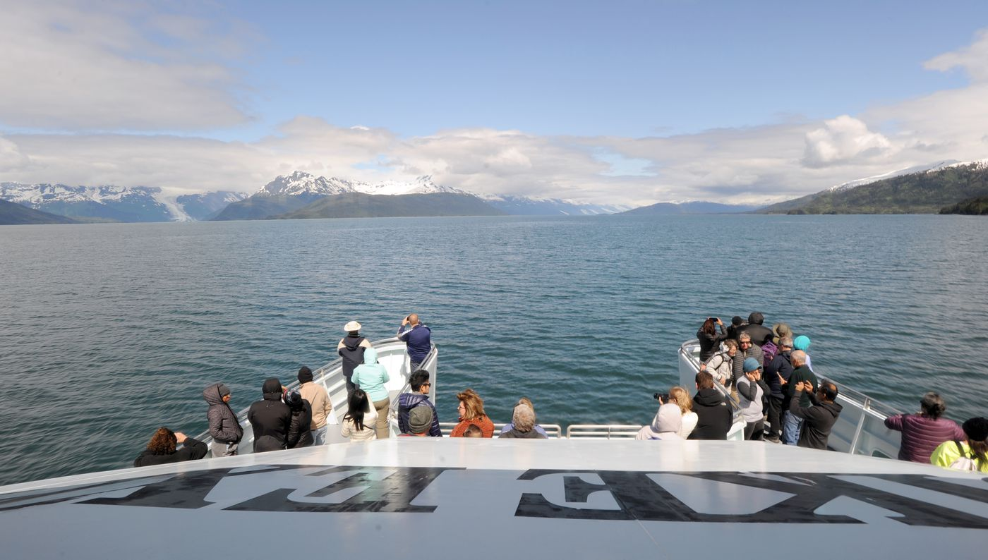 Tourists aboard the Klondike Express take in the sunshine of Prince William Sound. (Anne Raup / ADN)