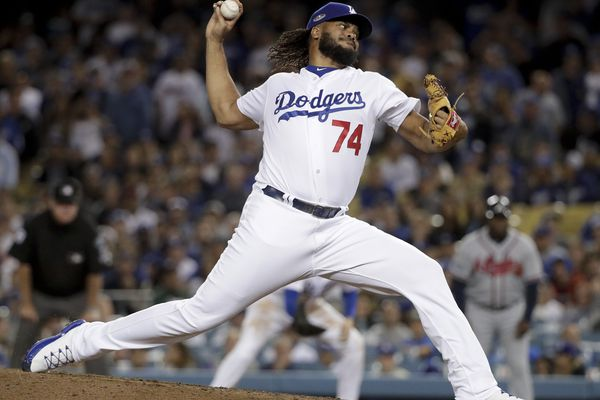 Los Angeles Dodgers relief pitcher Kenley Jansen throws to an Atlanta Braves batter during the ninth inning of Game 2 of a baseball National League Division Series on Friday, Oct. 5, 2018, in Los Angeles. The Dodgers won 3-0. (AP Photo/Jae C. Hong)