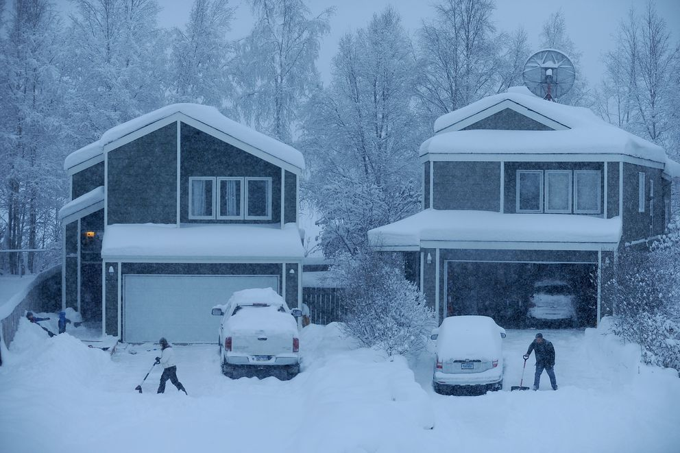 Residents shovel their driveways on Challenger Circle in west Anchorage, Alaska on Saturday, January 21, 2017. (Bob Hallinen / Alaska Dispatch News)