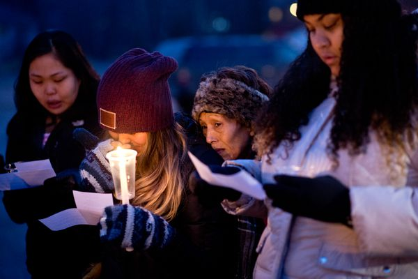 Tina Ballot, center, sister of Brian Ballot, listens during the candlelight vigil. Family and friends of Brian Ballot gathered in the parking lot of Muldoon Road Baptist Church on Wednesday evening, Nov. 2, 2017. Ballot was killed after he was struck by a vehicle at Muldoon Road and Fifth Avenue on Saturday. (Marc Lester / Alaska Dispatch News)