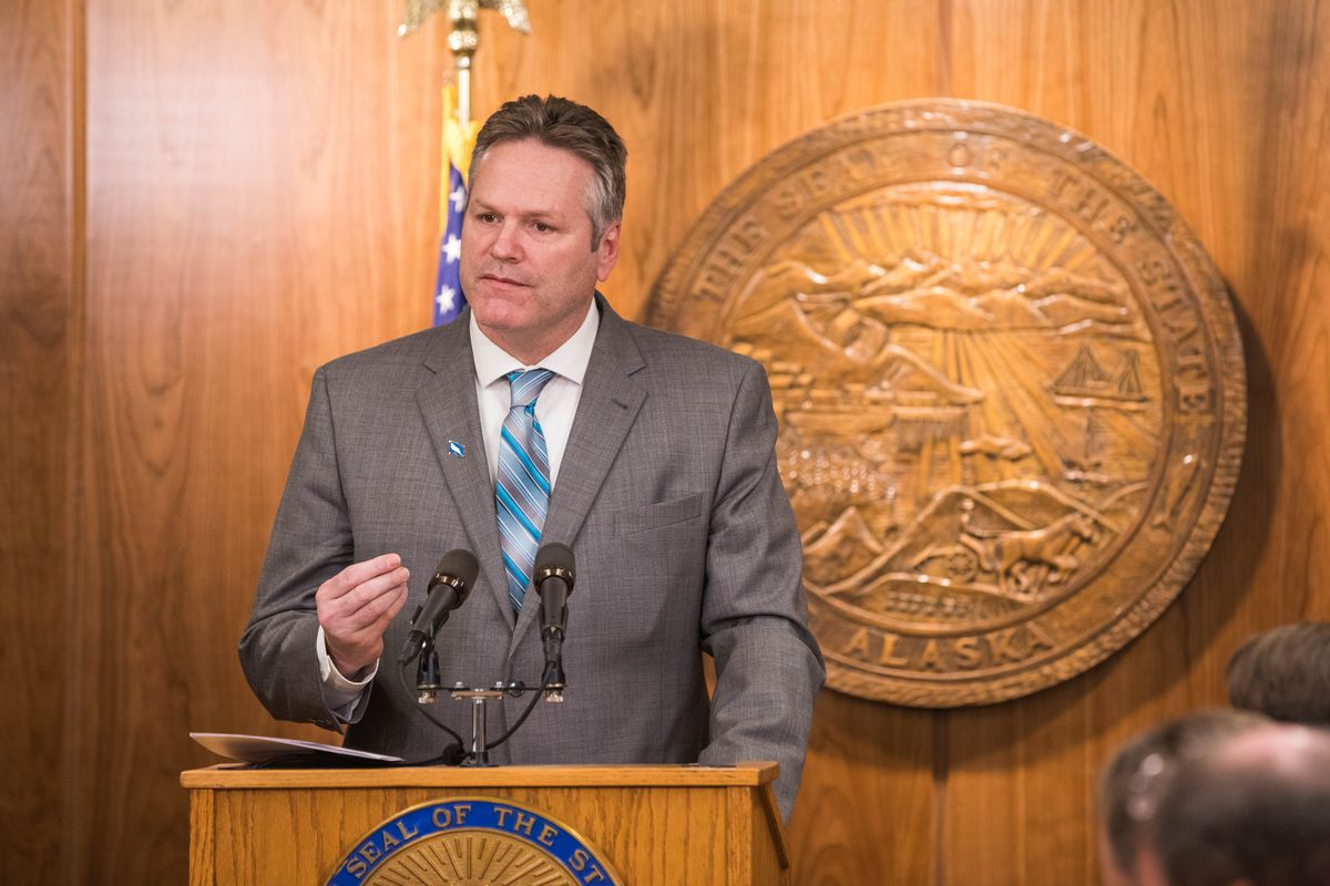 Gov. Mike Dunleavy speaks at a press conference on Jan. 16 at the Alaska State Capitol, where he announced a proposal to pay back Permanent Fund dividends that had been capped. (Loren Holmes / ADN)