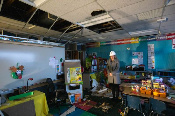 ASD superintendent Deena Bishop tours a classroom at Eagle River Elementary School on Tuesday, Dec. 4, 2018. The school was badly damaged in Friday's 7.0 earthquake, and will remain closed for the remainder of the school year. (Loren Holmes / ADN)