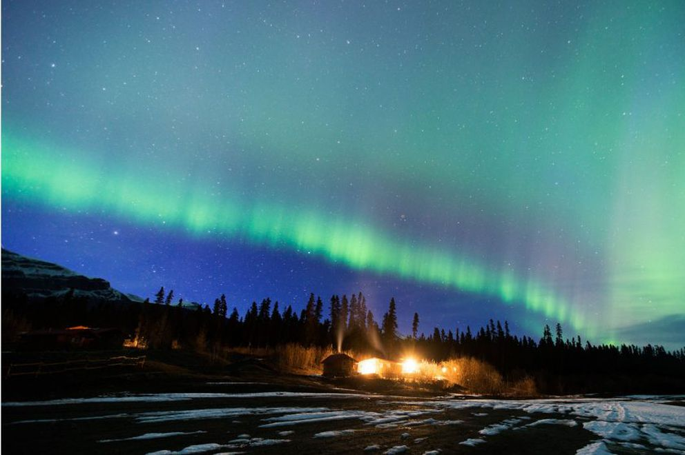 Northern lights fill the sky above the Ultima Thule Outfitters base camp. Photographer Kerry Tasker will be teaching a nighttime photography course Friday at Anchorage Museum. (Photo by Kerry Tasker)