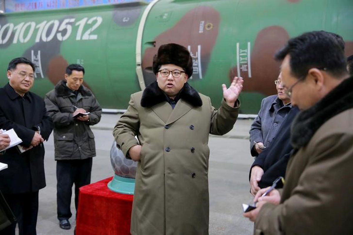 FILE PHOTO – North Korean leader Kim Jong Un meets scientists and technicians in the field of research into nuclear weapons in this undated photo released by North Korea's Korean Central News Agency (KCNA) in Pyongyang March 9, 2016. KCNA/Files via Reuters