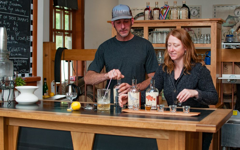 Sean Copeland and Heather Shade mix cocktails at the Port Chilkoot Distillery. (Andy Hedden)