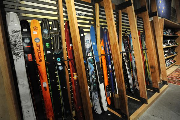 Alpine skis and boots in the new REI store in the Midtown Mall on Thursday, Jan. 17, 2019. (Bill Roth/ ADN)