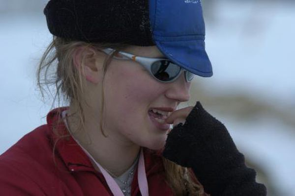 Rookie musher Rachael Scdoris contemplates her race so far as she takes a 24-hour layover in the village of Takotna during the 2005 Iditarod. (Robert Hallinen / Alaska Dispatch News archive)