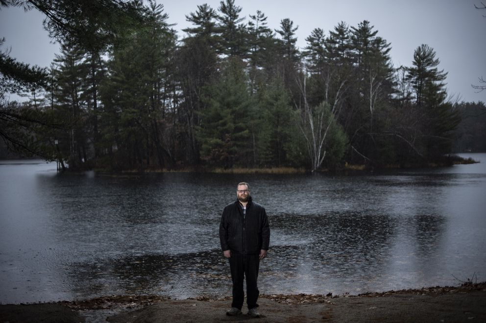 Christopher Blair, 46, in the woods near his home in North Waterboro, Maine, wanted to make fun of what he and others considered extremist ideas among the far right. He has built a community of more than 100 liberals to police his Facebook page. Washington Post photo by Jabin Botsford