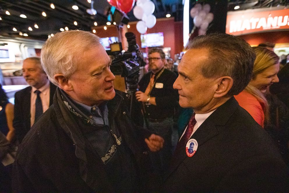 Former Lt. Gov. Mead Treadwell, left, chats with state Sen. Kevin Meyer at a Republican Party celebration Tuesday, Nov. 6, 2018 at the Anchorage Alehouse. Meyer is running for Lt. Gov. with Mike Dunleavy. (Loren Holmes / ADN)