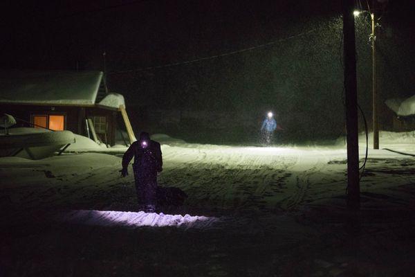 Jim Lanier walks to the Nikolai school on Tuesday, March 6, 2018 during the Iditarod Trail Sled Dog Race. (Loren Holmes / ADN)
