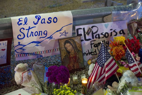 FILE - In this Aug. 4, 2019 file photo, a Virgin Mary painting, flags and flowers adorn a makeshift memorial for the victims of the mass shooting at a Walmart in El Paso, Texas. The vast majority of mass shooters have acquired their firearms legally with nothing in their background that would have prohibited them from possessing a gun. But there have been examples of lapses in the background check system that allowed guns to end up in the wrong hands. (AP Photo/Andres Leighton, File)