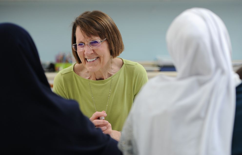 Retired teacher Cindy Johnson teaches a citizenship class for refugees through the Catholic Social Services on Tuesday. (Bill Roth / ADN)