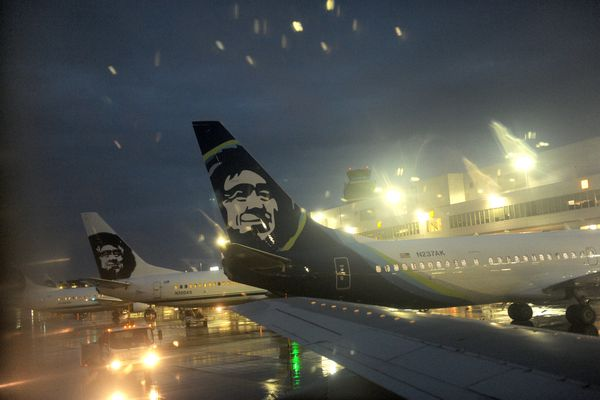 Rain greets passengers as an Alaska Airlines jet on a flight from Nome, AK pulls into the gate at Ted Stevens International Airport in Anchorage, AK on Monday, August 22, 2016. (Bob Hallinen / Alaska Dispatch News)