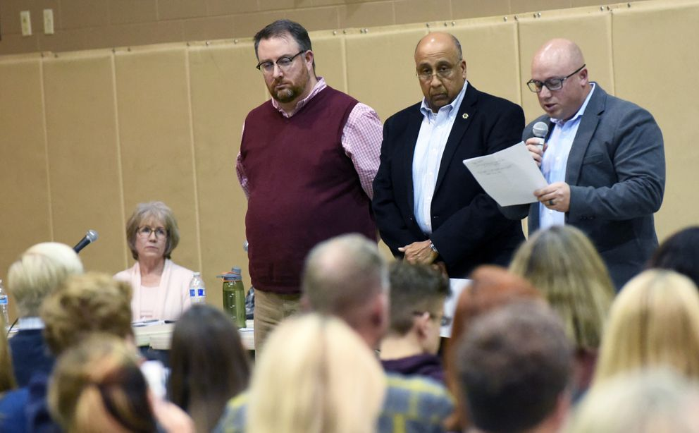 From left, Perry Lewis, Oscar Hall and Ty Witte make their presentation during a public forum on the future of Chugiak-Eagle River schools on Monday, Dec. 9, 2019 at Mirror Lake Middle School in Chugiak. (Matt Tunseth / Chugiak-Eagle River Star)