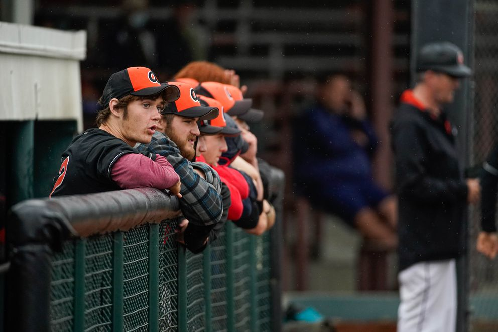 Members of the West Eagles watch from the dugout during their 3-0 victory over defending state champion Juneau in the first game of the state tournament at Mulcahy Stadium. (Loren Holmes / ADN)