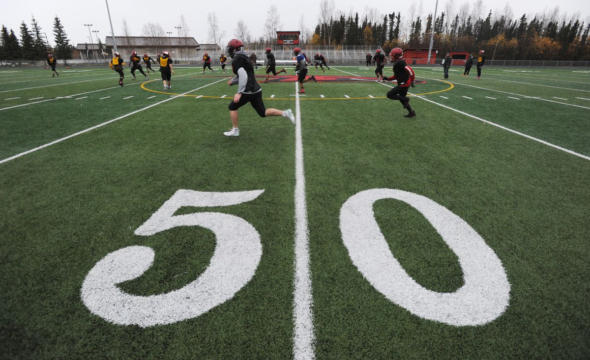The undefeated Houston Hawks practice in the rain on Wednesday in preparation for their small schools playoff game against the Eielson Ravens on Friday night. (Bill Roth / ADN)