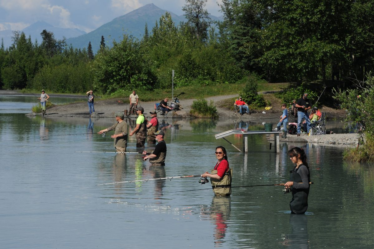 Priscilla Hunter, red shirt, teaches her granddaughter Emily Charles, 13, right, how to fish at the Eklutna Tailrace on Wednesday, July 5, 2017. (Bill Roth / ADN)